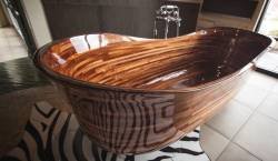 The old boat builder produces breathtaking wooden tubs